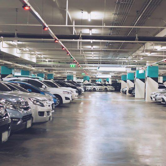 parking garage interior full of cars